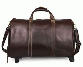 Дорожная кожаная сумка с колесиками